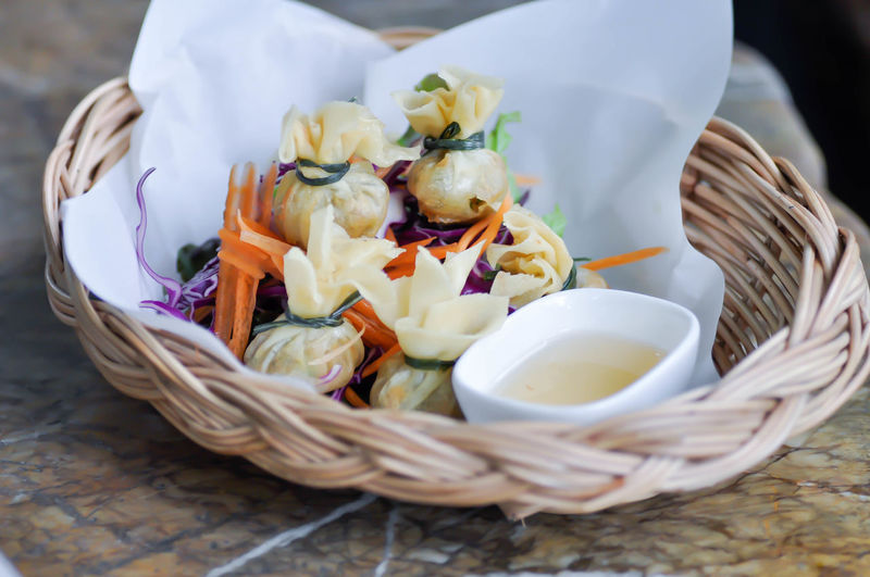 High angle view of vegetables in basket on table