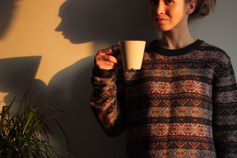 One Person Drink Holding Shadow Refreshment Waist Up Cup Adult Food And Drink Indoors  Casual Clothing Drinking Sweater Front View Real People Mug Lifestyles Coffee Cup Hairstyle Women This Is My Skin