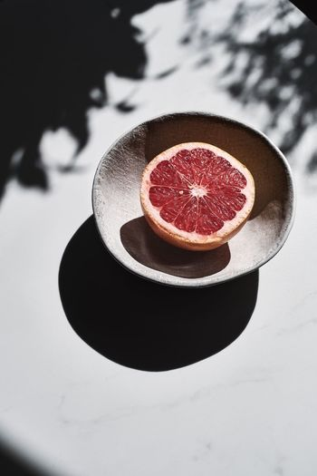 High angle view of strawberry on table