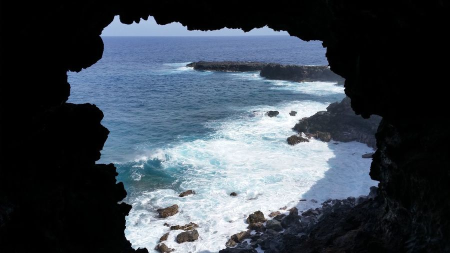 Scenic View Of Sea Seen From Cave At Easter Island