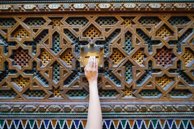 coins for luck Travel Destinations Travel Photography Digital Nomad EyeEmNewHere Morocco Fes Morocco Architecture Built Structure Low Angle View Day Pattern Design No People Art And Craft Creativity Building Exterior Building Representation The Past Full Frame Craft History Close-up Architectural Feature Human Representation Arms Raised Ornate Ceiling