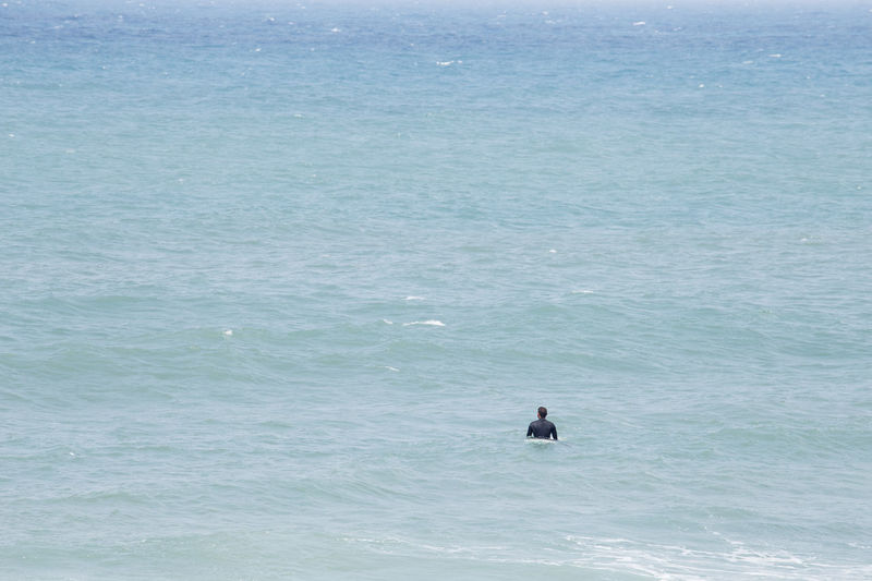 Alone Anticipation Surfer Waiting Wave Beauty In Nature Blue Day Full Frame Guidance Horizon Over Water Men Nature One Man Only One Person Outdoors People Real People Sea Summer Swimming Water Waterfront Weekend Activities Young Men Go Higher