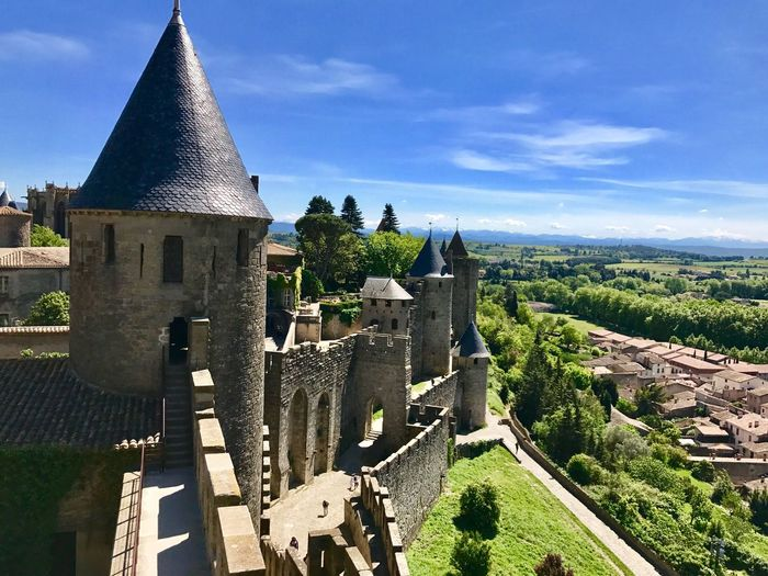 Castle and city. Architecture History Built Structure Building Exterior Day Sky High Angle View Castle Outdoors No People Sunlight Travel Destinations Tree Nature Ancient Civilization