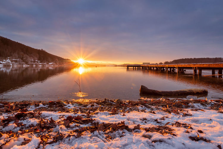 Beautiful sunset at the lake wallersee, austria, winter season
