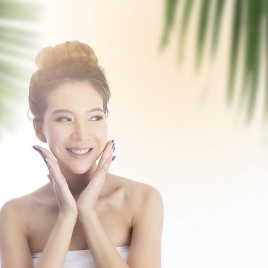 Happy beautiful asian girl with the fresh skin with sunlight background. Expressive facial expressions. Summer holiday concept. Branding Branding Mockup Cosmetics Cosmetic Products Cosmetic Mockup Beauty In Nature Close-up Sunblock Packaging Packaging Mockup Packaging Design Space Summer Summertime ♥ Vacations Nature