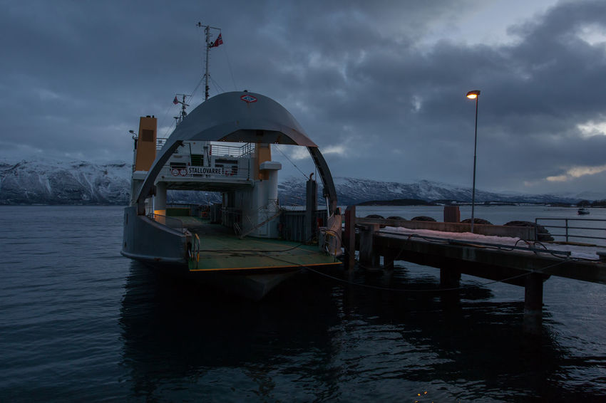 The ferry at Svensby, Norway Arctic Astronomy Beauty In Nature Boat Cold Dusk Ferry Ferryboat Fjord Frozen Harbour Jetty Mountain No People Norway Outdoors Polar Night Portrait Remote Scenics Snow Tranquil Scene Tromsø Water Winter
