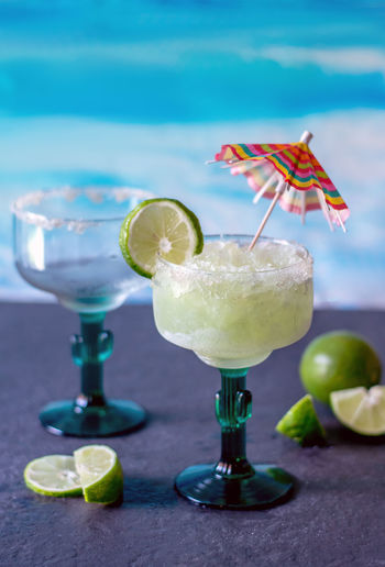 cold and icy frozen margarita drinks with slices of lime Frozen Margarita Margarita Summertime Alcohol Alcoholic Drinks Beach Drinks Citrus Fruit Close-up Cocktail Cold Drink Drink Umbrella Drinking Glass Empty Glass Food And Drink Freshness Frozen Beverage Fruit Garnish Glass Healthy Eating Icy Lime Refreshment SLICE The Creative - 2018 EyeEm Awards