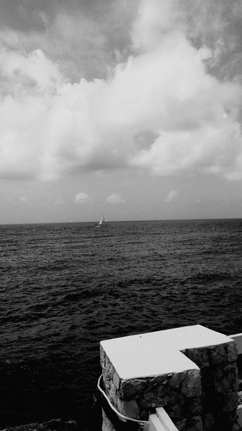 Sea Water Cloud - Sky Horizon Over Water Nature Day Outdoors No People Sky Tranquility Beach Beauty In Nature Travel Destinations Vacations Scenics sailboat isolation EyeEmNewHere