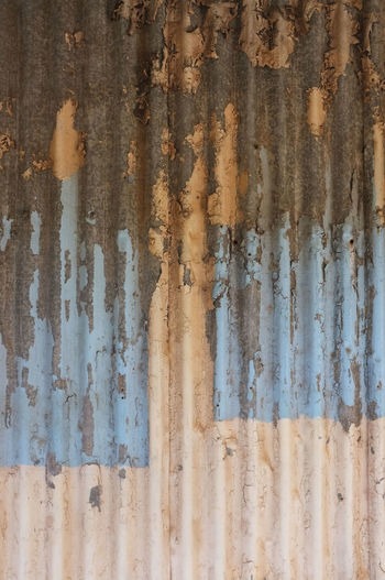 Paint on old corrugated iron. Corrugated Lines Abstract Backgrounds Close-up Corrugated Iron Corrugated Iron Rusting Cracking Paint Damaged Full Frame No People Pattern Pealing Paint Rusty Textured  Weathered