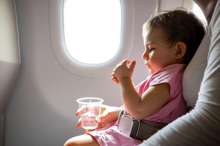 Boy sitting in airplane