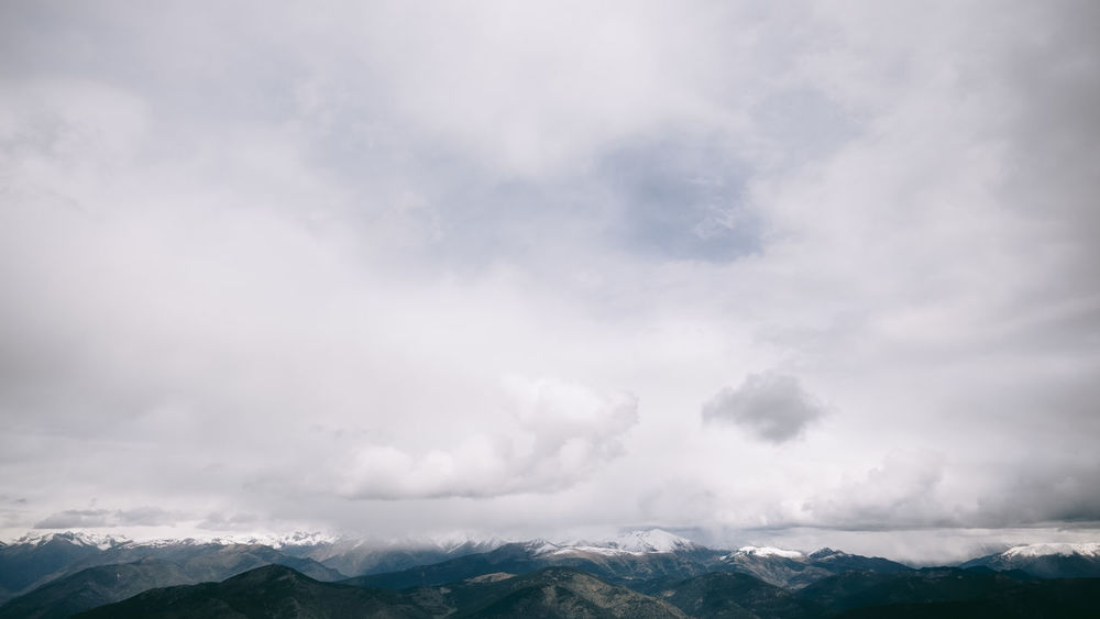 Clouds And Mountains Cloudy Earth Horizon Over Land Mountain Range Mountains Mountains And Sky No People Non-urban Scene Outdoors Remote Sky And Clouds Tranquility Vertical Landscapes Weather