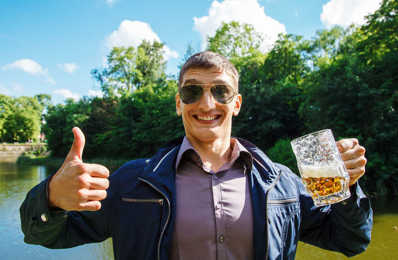 Portrait of smiling man drinking beer