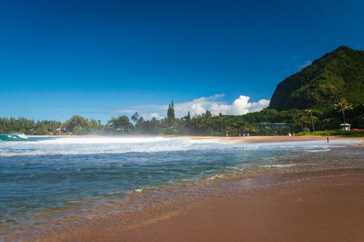 Scenic view of haena beach park on the hawaiian island of kauai, usa against blue sky
