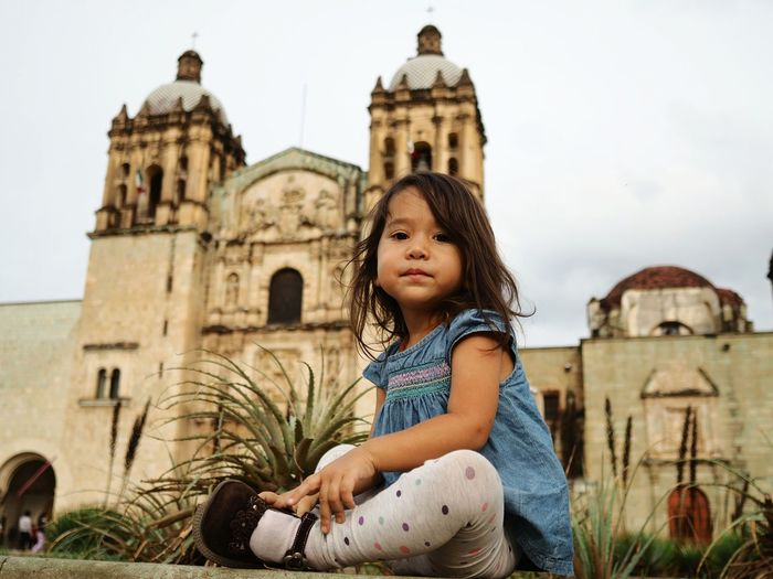 Posing by Santo Domingo in Oaxacade Juarez, Mexico EyeEm Selects Building Exterior Children Only Built Structure Architecture One Girl Only Outdoors Travel Destinations Travel Child Childhood One Person History Vacations Day People Sitting Sky Real People Oaxaca De Juárez Mexico Santo Domingo Church Religious Architecture Religion