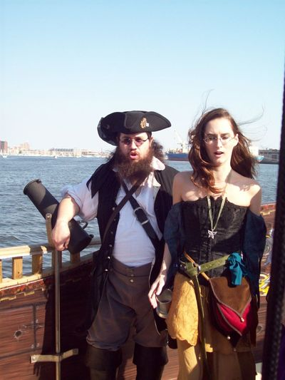 peopleandplacesTwo members of a (my former) local pirate band performing at a wedding offshore in Baltimore, Md. Boating Boatinglife Lifestyles Parties People Photography Peopleofeyeem Pirates Singers Thisweekoneyeem Festival Season