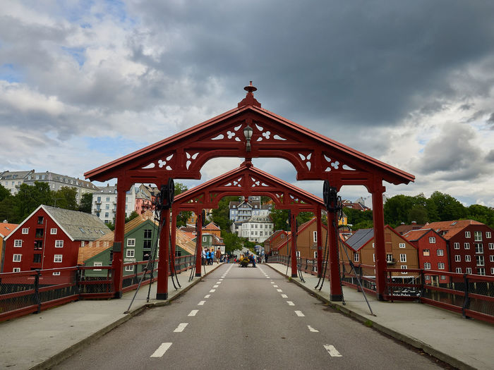 Low angle view of bridge against buildings