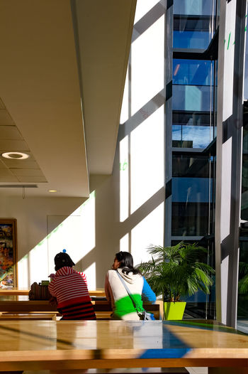 Two people at table, indoors at Salvation Army HQ cafe, central London, close to Millennium Bridge and St Paul's Cathedral. Salvation Army Sunlight Cafe Day Desk Education Indoors  Men Modern Office Office Building People Real People Reflections Salvation Army Cross Shadow Urban Building Street Photography Photographer Photograph Documentary Reportage Street Taking Photos Shots Images Black And White Monochrome Shadow Sitting Window Women Working The Week On EyeEm