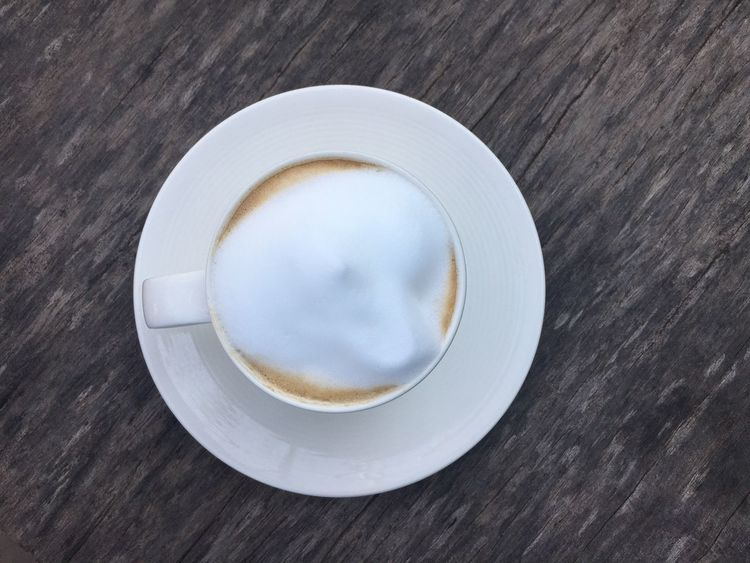 Cup of coffee top view on wood ground Food And Drink Close-up Refreshment Drink Freshness Brown Morning Breakfast Freshness White Bubble Cup Delicious Tasty Meal Cuisine