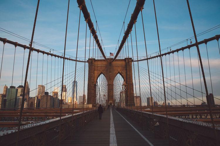 Brooklyn bridge against sky in city