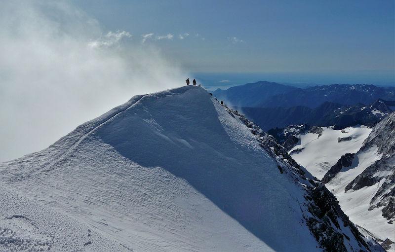 Mountaineers climbing on the ridge of weissmies, alps, switzerland