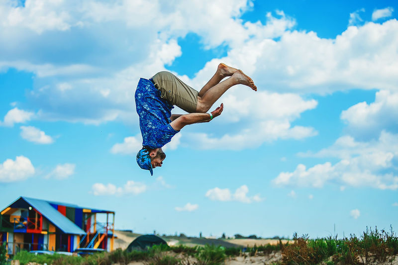 A man jumps high on a trampoline makes a somersault. Frame in motion. Beautiful sky. Summer mood. Fun Funny Happiness Happy Happy People Jump Life Life Is A Beach Lifestyle People Watching Real Sky And Clouds Jumper Jumping Jumpshot Lifestyles People people and places People Photography Peoplephotography Pleasure Real Life Real People Sky Sky_collection