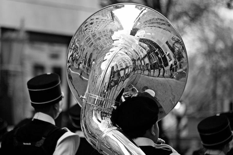 People Celebrating St Patrick Day With Reflection On Tuba