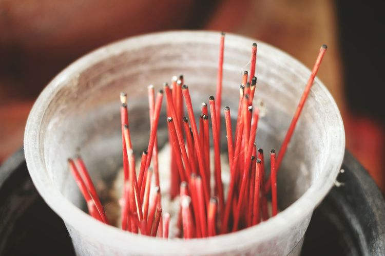 High angle view of incense sticks in container