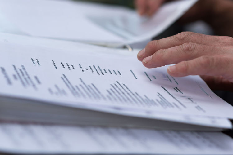 Paperwork Business Man Reading Working Book Close-up Day Finger Fingers Folder Hand Human Body Part Human Hand Mature Adult Mature Men Men One Person Paper Papers Paperwork People Real People Selective Focus Writing