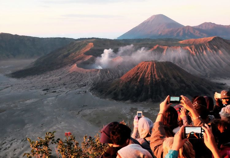 People photographing volcanic landscape