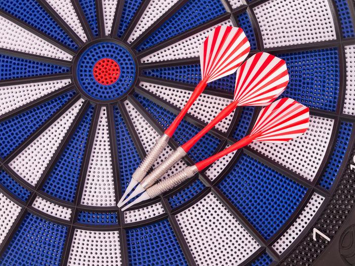 Close-up of darts on dartboard