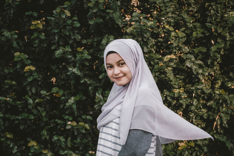 EyeEm Best Shots EyeEmNewHere INDONESIA Adult Beautiful Woman Day Headscarf Hijab Leisure Activity Lifestyles Looking At Camera Nature One Person Outdoors Plant Portrait Real People Smiling Standing Tree Waist Up Women Young Adult Young Women
