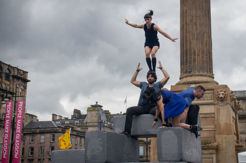 Block, performed by Motionhouse. From the 2016 Merchant City Festival Acrobats Arts Block City Cloudy Dance Dancers George Square Glasgow  Ground Merchant City Festival Motionhouse People Performance Picoftheday Pillar Portraits Scotland Sky Tower Of People Trooper My Year My View