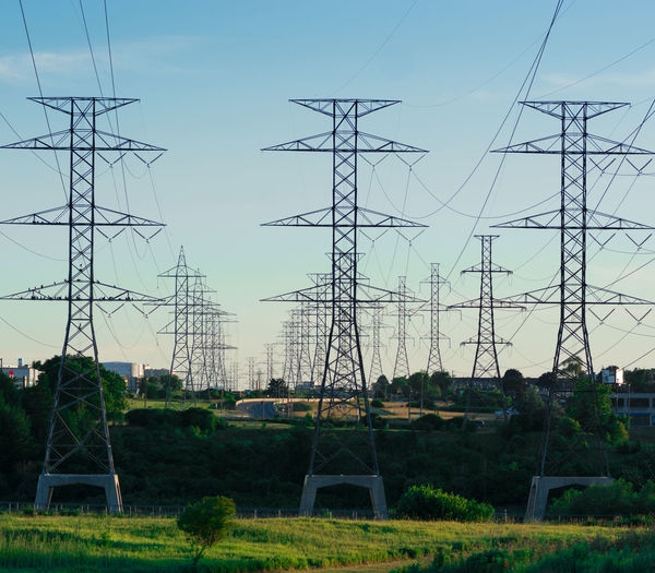 Architecture Building Exterior Built Structure Cable Complexity Connection Day Electrical Grid Electricity  Electricity Pylon Fuel And Power Generation Low Angle View Nature No People Outdoors Plant Power Line  Power Supply Sky Tall - High Technology Tree