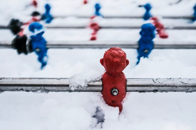 Close-up of snow covered foosball
