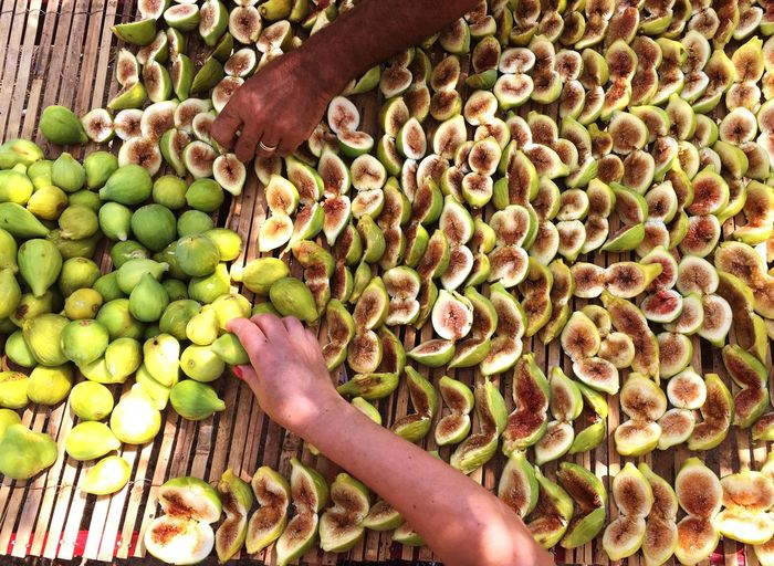 High angle view of hand holding fruits at market