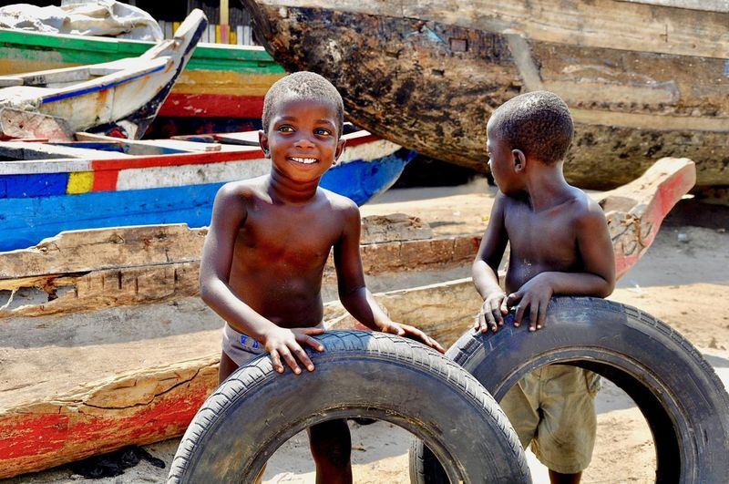 Smiling boys playing with tire
