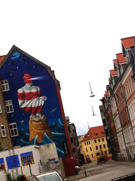 The Street Photographer - 2016 EyeEm Awards Aalborg Cityscape Sky Day Building Exterior City Cloud - Sky No People Outdoors Grafiti Art Lighthouses Finding New Frontiers Adapted To The City