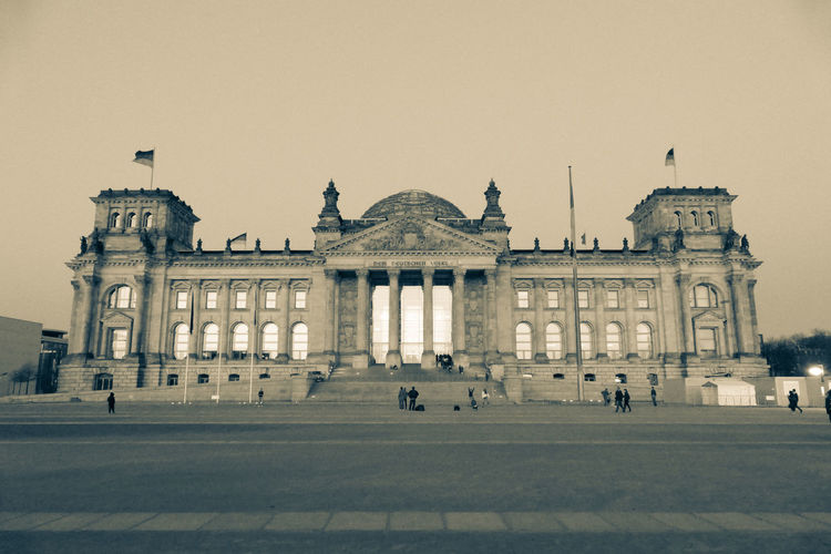 Reichstag Architectural Column Architecture Building Exterior Built Structure City Clear Sky Crowd Façade Government Group Of People History Incidental People Large Group Of People Nature Outdoors Real People Sky The Past Tourism Travel Travel Destinations