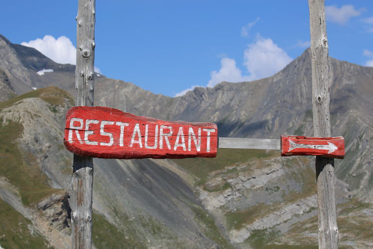 Restaurant Sign Against Rocky Mountains