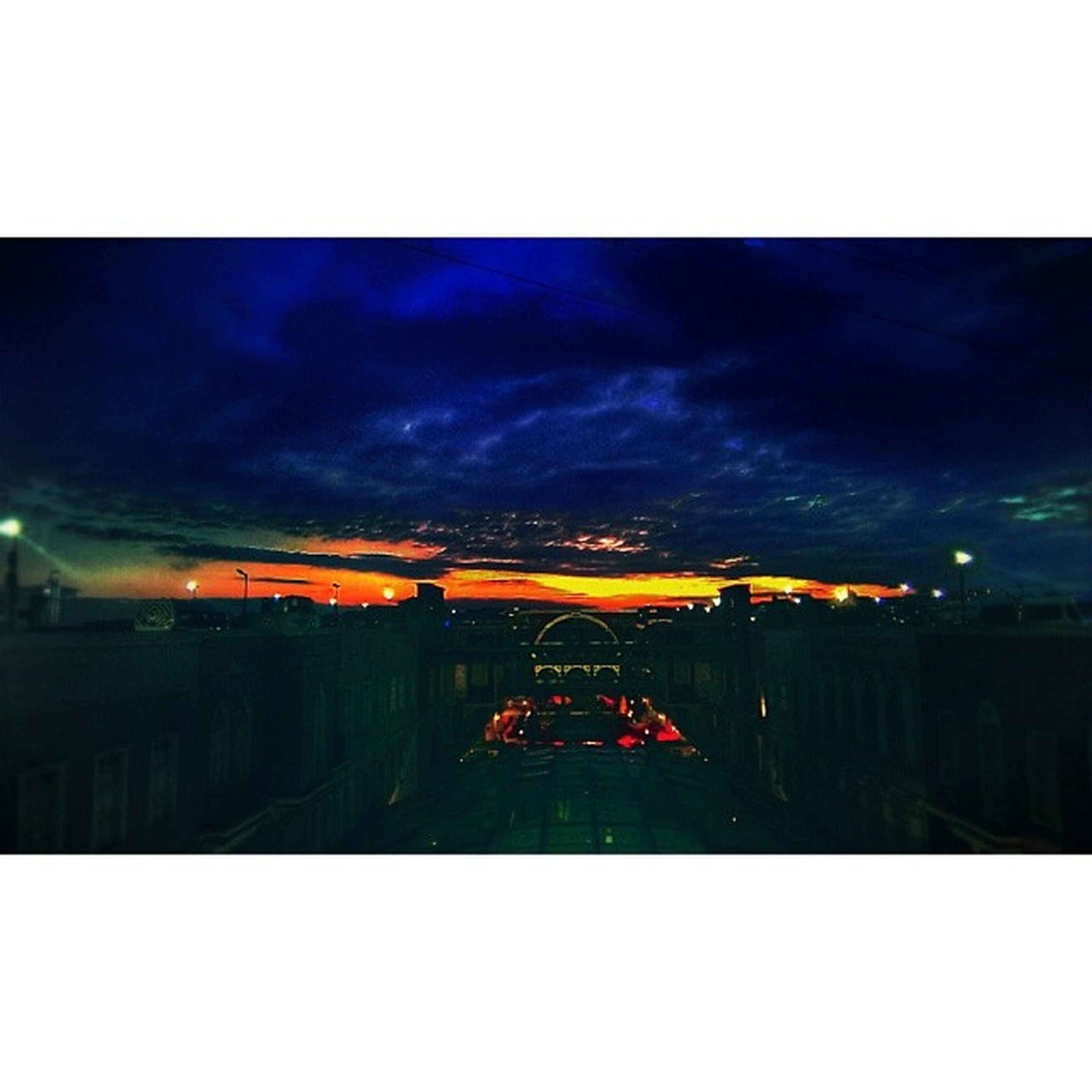 transfer print, auto post production filter, sky, illuminated, building exterior, sunset, built structure, architecture, cloud - sky, dusk, night, cloudy, outdoors, city, cloud, silhouette, dark, dramatic sky, no people, landscape