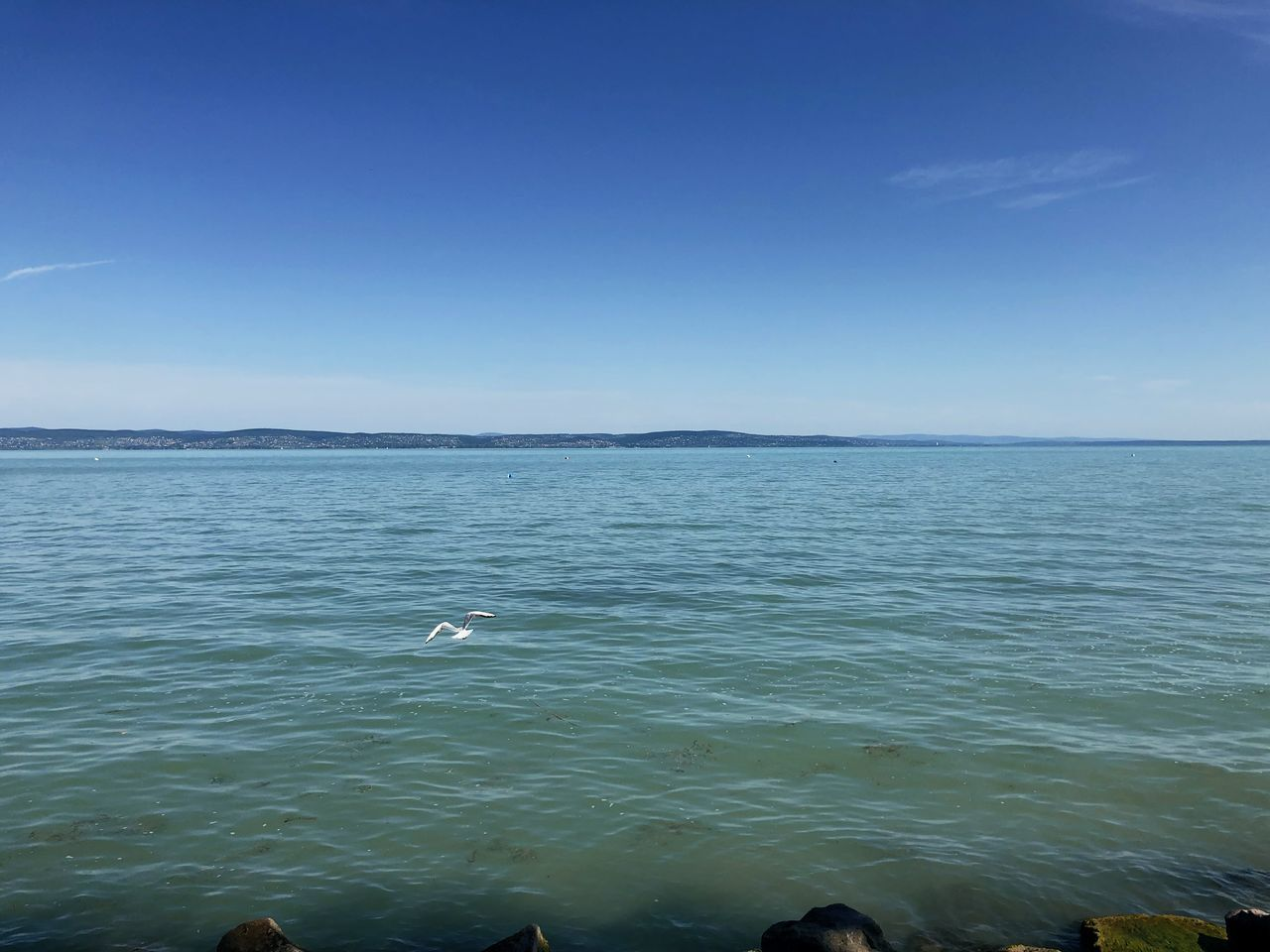 VIEW OF SEA AGAINST CLEAR BLUE SKY