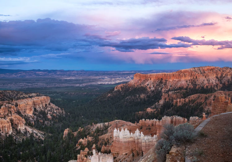 Beauty In Nature Bryce Canyon Canyon Cloud - Sky Countryside Distant Dramatic Landscape Eroded Extreme Terrain Hoodoos Landscape Majestic Mountain Mountain Range Nature Outdoors Red Rocks  Remote Rock Formation Scenics Sky Sunset Tourism Travel Travel Destinations