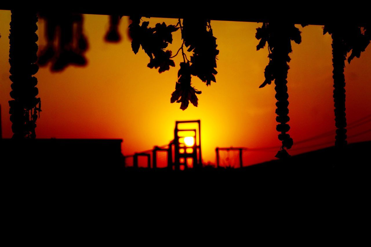 sunset, silhouette, orange color, hanging, nature, no people, sun, beauty in nature, sky, scenics, tranquility, built structure, outdoors, tree, architecture, close-up, day