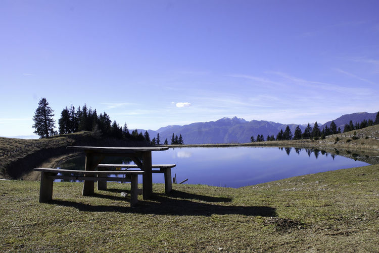 golte mountain lake Beauty In Nature Bench Blue Day Golte Lake Mountain Nature No People Outdoors Scenics Sky Slovenija Table Tranquil Scene Tree Water Miles Away Mirror Water Reflections Water Mirror Sky Reflections In The Water Shadowplay Shadows & Lights Panoramic Landscape