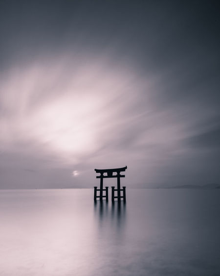 Torii Gate In Sea During Sunset