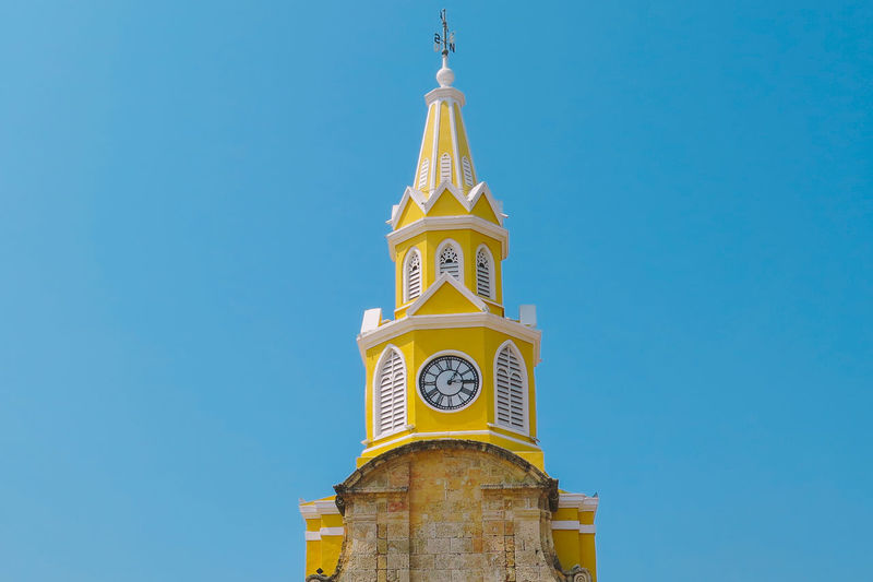 Low Angle View Of Church Clock Tower Against Clear Blue Sky
