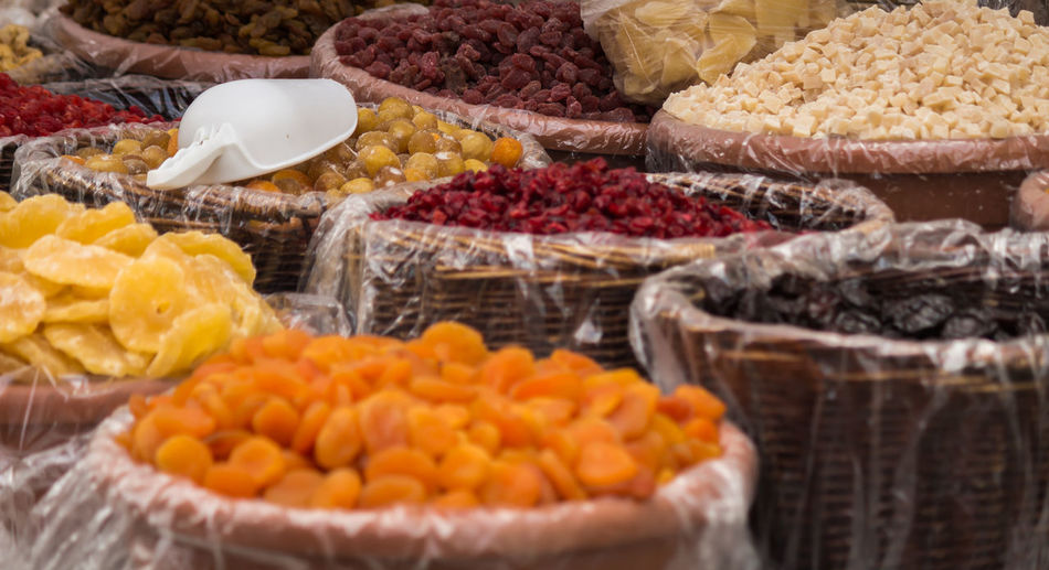 Dried fruits in baskets at the market of Stresa, Italy Abundance Arrangement Basket Choice Close-up Focus On Foreground Food Freshness Indulgence Large Group Of Objects Market Market Stall No People Orange Color Organic Ready-to-eat Retail  Selective Focus Still Life Variation Yellow