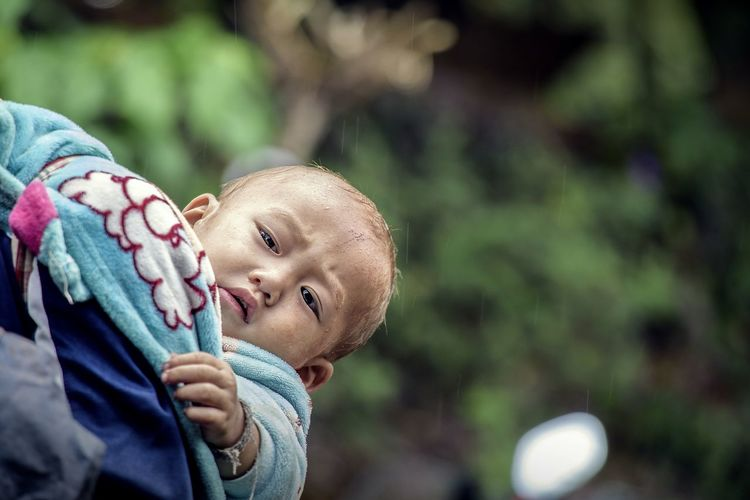 Close-up portrait of hill tribe baby outdoors