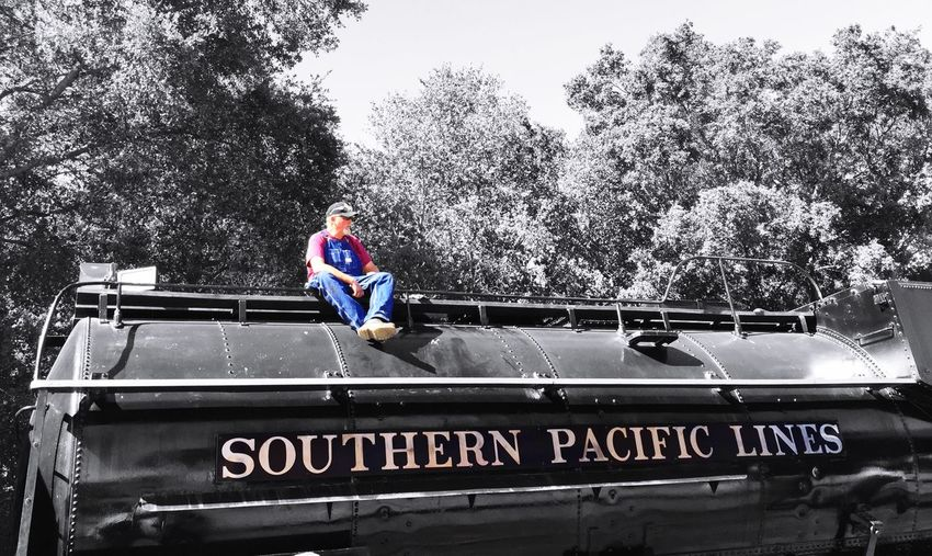 """Engineer Break"" Train engineer taking a break atop the Southern Pacific Lines engine at his command on the historic Niles Canyon Railway in Sunol, California, USA. Railroad Engineer Trainengineer Train Trainengine Historictrain Train Station Trains Trainphotography Southern Pacific"