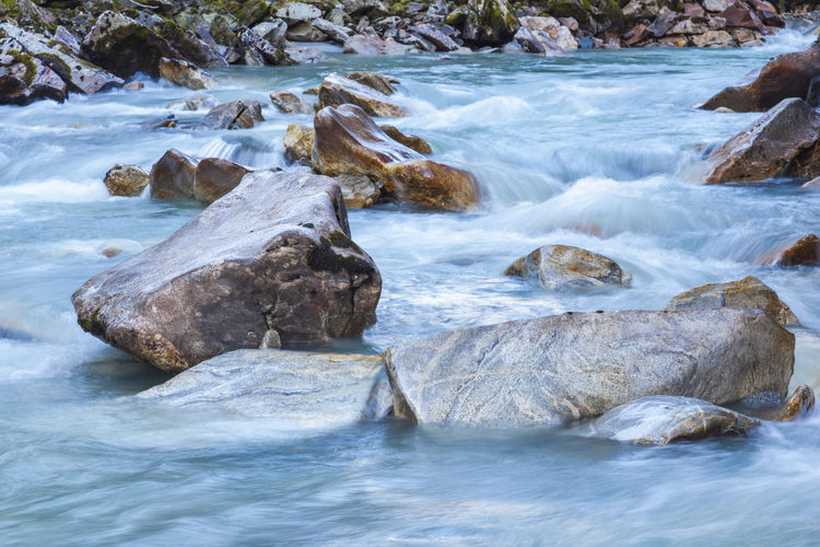 Rocky glacier river with turquoise water